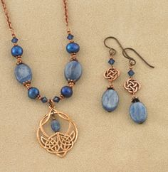 "Exclusive! The cool ethereal blues of air and water meet the warm tones of fire and earth. Kyanite - the gemstone of dreams - lifts your spirit, while copper keeps you grounded. Blue pearls, crystals and kyanite are accented with eternal knotwork in glowing copper. Earwires are hypoallergenic niobium; necklet is 18"" long. Made in USA."