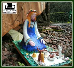"""""""Wiccan girl sitting by her shrine"""".One of a kind. Hand made enameled and lacquered porcelain sculpture,12 cm. tall, on wood base 10 x 18 cm. Beautiful details! On her shrine's doily blanket there's a bell, incense burner with it`s incense stick, a tiny athame with carved handle and lanceolated blade, bowls of water, salt and cookies, chalice and magic wand with tiny details, images of the Horned God and Mother Goddess with their candles, pentagram and a leather book of Shadows. #wicca"""