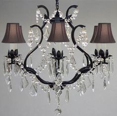 Features:  -Versailles collection.  -Number of lights: 6.  -Material: Wrought iron.  -Shade color: Black.  -This item also works with energy efficient bulbs, halogen bulbs, compact fluorescent bulbs,