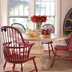 Considering a round extending dining table.  Love this with the red chairs.