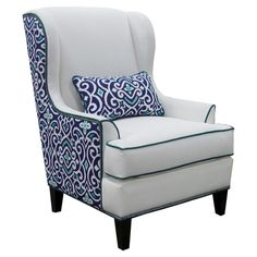 Wing chair in oyster with damask-print back upholstery and pewter nailhead trim. Great for an open-concept living room. Beautiful from the front and back!
