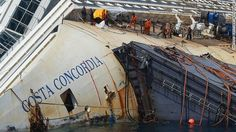 Salvage workers prepare the Costa Concordia cruise ship on August 23, 2013 at Giglio Island.