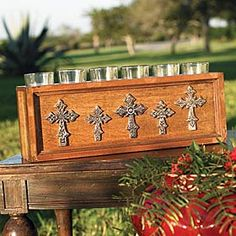 "CROSS BOX VOTIVE HOLDER  _  An attractive and useful accessory that holds up to six votive candles, not included. Picture frame side panels are embossed with decorative metal crosses. 16 1/2"" x 3 3/4"" x 6"". _ PRICE 		$90.00"