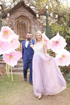Giant paper flowers make this Whimsical Pink Alice in Wonderland Wedding super gorgeous! Hello Love Photography