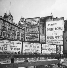 London 1942 - billboards advertising some of the entertainment on offer. (photograph by David E. Scherman)