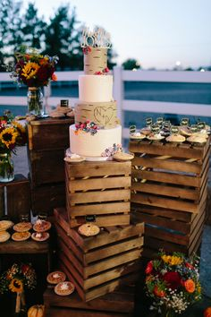 Rustic cake display with crates and mini pies. Legends Ranch Las Vegas Wedding.