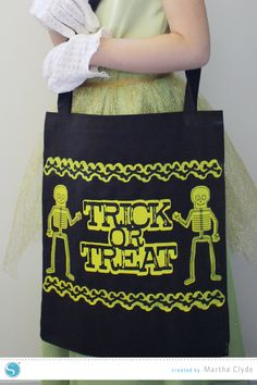 Glow in the Dark Trick or Treat Bag using heat transfer material and fabric ink.