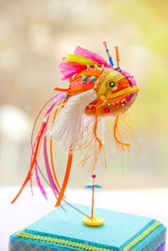 This is actually fiber arts, but I like it better in a paper mache' capacity.  Wouldn't this be fun to do?