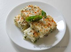 Rava Dhokla Recipe    Ingredients        1 Cup Semolina Flour (Sooji / Rava)      1/2 Cup Corn      1/2 Cup Fenugreek Leaves (fresh methi leaves), finely chopped      1 Cup Yogurt      1/2 Cup Water      1 inch Piece Ginger, grated      1 Green Chili, finely chopped      1 Teaspoon Eno's Fruit Salt      1 Tablespoon Oil      Salt to Taste      For Tempering:      2 Tablespoons Oil      1/2 Teaspoon Mustard Seeds (Rai)      1 Teaspoon Sesame Seeds (Til)      1 Green Chili, cut 1 inch pieces