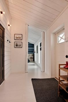 I am beginning to adore clutter free clean white entryways.  But I've always wanted a mudroom anyhow... maybe one day!