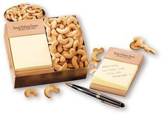 Note Holder with Cashews!  We apply a hand-rubbed natural oil finish to bring out the natural beauty of the American Beech wood, then firebrand your logo on the holder. Of course, we include Extra Fancy Jumbo Cashews, five-ounces. Food gifts make excellent gifts for your holiday gift program!