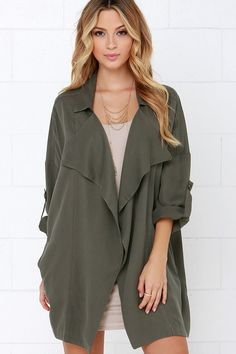 They say luck be a lady, and she must be a fashionable one with numbers like the Lucky Break Olive Oversized Jacket! Medium-weight woven fabric in a grey shade of olive green shapes a collared, draping front with vertical welted pockets. Oversized bodice tapers slightly into short dolman sleeves that can be rolled up and kept in place with a handy button tab. As Seen On Sara of @stylemba!