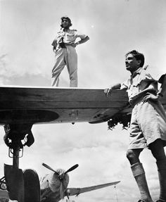Two Indian Air Force pilots (Flight Lieutenant Lal and Flying Officer M M Sakhre) pose with their Vultee Vengeance dive bombers at an airfield in Assam, India, from where they attacked the Japanese in Burma. CI 702