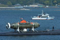 Deep Submergence Rescue Vehicle Mystic (DSRV-1) mounted aft on USS La Jolla SSN-701.  Mystic was specifically designed to fill the need for an improved means of rescuing the crew of a submarine immobilized on the ocean floor. It can operate independent of surface conditions or under ice for rapid response to an accident anywhere in the world.