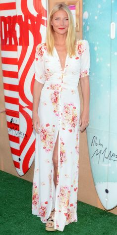 Gwyneth Paltrow in a flower-strewn floor-grazing dress and lace-up Paul Andrew espadrilles.