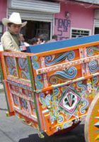 """Oxherding and Oxcart Tradition in Costa Rica """"...The tradition of painting and decorating oxcarts started in the early twentieth century. Originally, each region of Costa Rica had its own particular design, enabling the identification of the driver's origin by the painted patterns on the wheels. By the beginning of the twentieth century, flowers, faces and even miniature landscapes appeared beside patterns of pointed stars..."""""""