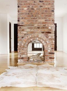 Love this 2-sided fireplace. Wish we could have a wood burning one. Not sure a…