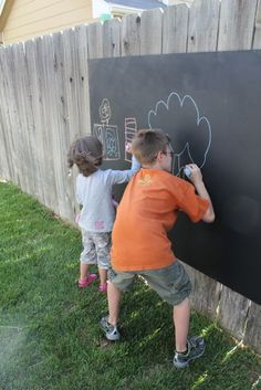 Outdoor Chalkboard. Birch plywood,  painted front and back with primer to seal it, and then we just painted the front with a quart of chalkboard paint. Attached to the fence with galvanized wood screws.    So far so good, it's been 9 months and it looks brand new.