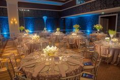 This #corporate #venue does not apply #unified #decorations for every the tables: some are common #table #cloth, some #embroidered; some use #tall #centerpieces, some #short ones. The #blue #LED #lights along the wall add a touch of night atmosphere to the #party.