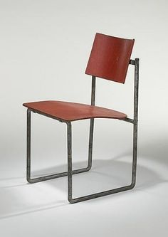 """GERRIT RIETVELD    Schroeder House Dining Room Chair    G.A. van de Groenekan  The Netherlands, c. 1925  steel, lacquered plywood  17.5 w x 20 d x 32.75 h inches  This rare chair represents Rietveld's first experimentation with steel in chair design. Rietveld developed the use of steel and plywood in a number of successive designs, including the Beugelstoel of 1927. The Schroeder chair is considered a prototype """"in terms of its combination of materials"""" although not in the details of its…"""