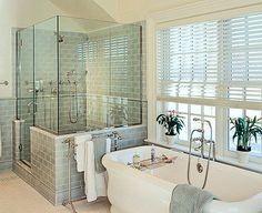 This is what I want.  We have this layout already. I really like the freestanding soaking tub, the windows,the see-through shower. Master Bath inspiration, soaking tub, blue/green subway tile... Waterworks, Ice Water Blue Field Tile, Kohler Tub