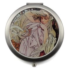 Compact mirror with Four Seasons design for touch-ups on the go. A lovely companion that easily fits in any purse.