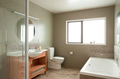 Netural delight mid green-brown Resene Grey Olive balances out white bathroom fittings. Bathroom Colors, White Bathroom, Bathroom Trends, Bathroom Ideas, Resene Colours, Rural Retreats, Colour Board, Green And Brown, Corner Bathtub