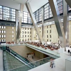 Hearst Tower, NYC - The atrium features escalators which run through a 3-story water sculpture titled Icefall, a wide waterfall built with thousands of glass panels, which cools and humidifies the lobby air. The water element is complemented by a 70-foot-tall (21 m) fresco painting titled Riverlines by artist Richard Long.