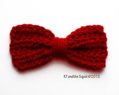 Crochet bow - Without buying the silly pattern, I'm pretty sure it's just three rows of single crochet with a bunch of plain yarn wrapped around the middle, haha.