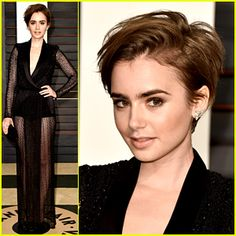 Lily Collins wears a super chic sheer dress while walking the carpet at the Vanity Fair party following the 2015 ...