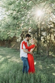 A flowy red dress is a top notch choice for engagement photos | Image by Abby Weeden Photography