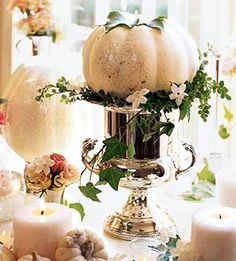 Pumpkins are perfect way to decorate your fall table – a dinner, a Halloween party or a Thanksgiving table. Here are ideas to make centerpieces of them. White Pumpkin Centerpieces, Fruit Centerpieces, Centerpiece Ideas, Disney Centrepieces, Floral Centrepieces, Pumpkin Arrangements, Silver Centerpiece, Halloween Wedding Centerpieces, Thanksgiving Centerpieces