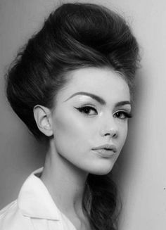 Beehive hair with heavy eyeliner