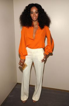 SOLANGE KNOWLES Silky orange top with slashes on the sleeves. Yep, it must be summer. Solange breaks out the seasonally-appropriate look when she joins her sister at the Chime for Change event in N. Solange Knowles, Fashion Moda, Love Fashion, Fashion Looks, Paris Fashion, Style Work, Her Style, Mode Inspiration, Ideias Fashion