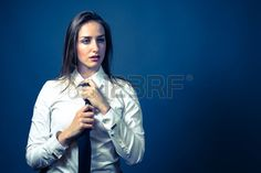 American female wearing a whtie button up shirt with a black tie Stock Photo