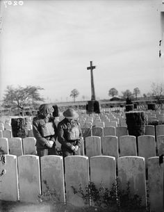 THE BRITISH ARMY IN FRANCE 1939. Two soldiers pay their respects at a British First World War cemetery, 5 November 1939