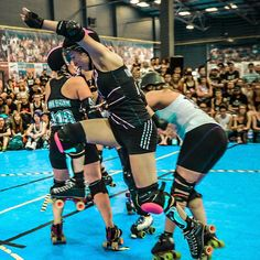 Trisha Smackanawa mid-jump at London Rollergirls Brawling All-Stars vs Rose City Wheels of Justice. Photo by John Hesse Swindon Futsal Arena August 8th 2015. by londonrollergirls