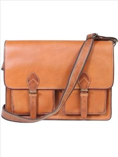Leather flap-over computer brief. Single gusset with padded computer compartment. Two open front pockets under flap. Adjustable and removable shoulder strap. 16W 12.5H 3D