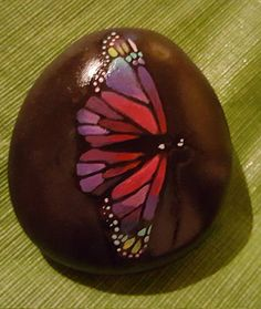 painted butterfly rock by StoniesbyHeidi on Etsy