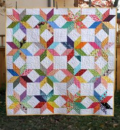 I am completely in love with this quilt. It's going to be so hard to take this one to the post office!   This quilt uses Jennifer's starflow...