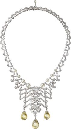 "CARTIER. ""Écume"" Necklace - platinum, three fancy yellow/fancy light yellow VS1 briolette-cut diamonds totalling 74.24 carats, four D/E VVS1/VVS2/VS1 oval-shaped diamonds totalling 13.15 carats, eight button-shaped and round-shaped white cream natural pearls totalling 82.12 grains, one 0.64-carat briolette-cut diamond, oval-shaped diamond, brilliant-cut diamonds. The necklace can be worn in different ways. #Cartier #RésonancesDeCartier #FancyYellowDiamond #Diamond #NaturalPearl"