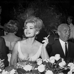 Maybe this is how men generally feel around beautiful  powerful women... (Zsa Zsa Gabor Turns 95 | Zsa Zsa Gabor smoking) http://www.pinterest.com/pin/225461525065056120/