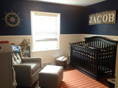 Orange and Navy Nautical Nursery - love the fencepost name sign over the crib!