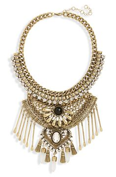 Make a statement with this bold necklace from Leith. Layers of antiqued chains, dancing spoon charms and glimmering crystals combine with some serious boho street cred.