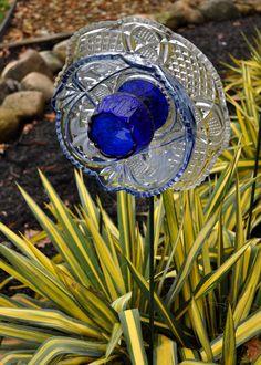 "Recycled Glass Flower Sun Catcher Garden Art, Garden Decor - Made of Glass Plates, ""Blue Lace"" Exquisite Flower. $40.00, via Etsy."