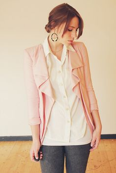 White shirt pink cardigan With gray pants