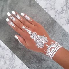 + Ideas for Mehndi - The Gorgeous Indian Henna Tattoo Art - contarsting white nail polish, and a cute henna tattoo in white, on a tan hand, placed over a grey - Henna Tattoo Muster, Fake Tattoo, Henna Tattoo Hand, Hand Tattoos, Tattoo Art, Mehndi Designs, Henna Tattoo Designs, Tattoo Designs For Women, Cute Henna Tattoos