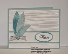 Unique card full of glimmer,shimmer, and shine.  Features Stampin' Up's Feathers Framelits Dies, Petite Pairs stamp set and Woodgrain Embossing Folder.  Learn how to color your Stampin' Up! Dazzling Diamonds Glimmer Paper and Watercolor Paper with our Stampin' Spritzers!  Visit my Blog here: http://stampininthesand.blogspot.com/2014/11/all-that-shines-feathers-framelits.html