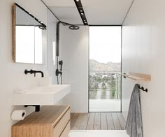 Photo 6 of 9 in A $185K Prefab Guesthouse Pops Up on a Tricky Hollywood Hillside - Dwell Bathroom Windows, Ensuite Bathrooms, Wood Bathroom, Small Bathroom, Prefab Office, Open Showers, Unique Architecture, Wall Mounted Sink, Concrete Steps