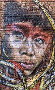 Artwork by Adnate and Shida in Fitzroy